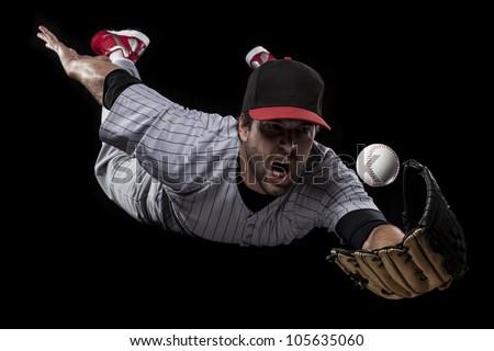 Baseball Player catching  a ball - stock photo