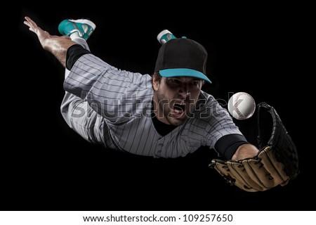 Baseball Player catching a blue uniform. - stock photo