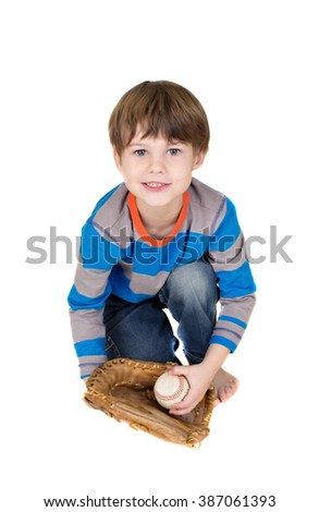 Baseball player: child catching a baseball in a mitt