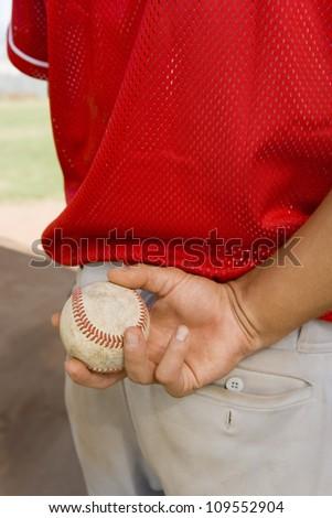 Baseball player holding a soft ball - stock photo