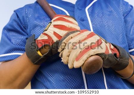 Baseball player holding baseball bat - stock photo
