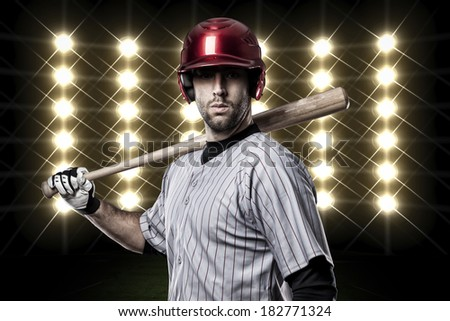 Baseball Player in front of lights. - stock photo