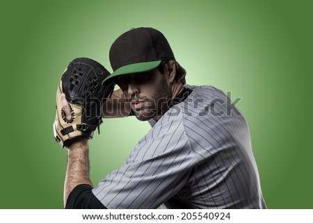 Baseball Player on a Green Uniform on Green background.