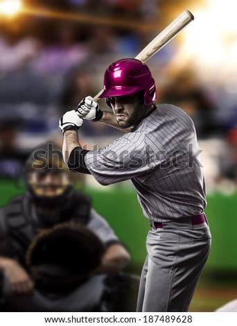 Baseball Player on a Pink Uniform on baseball Stadium. - stock photo