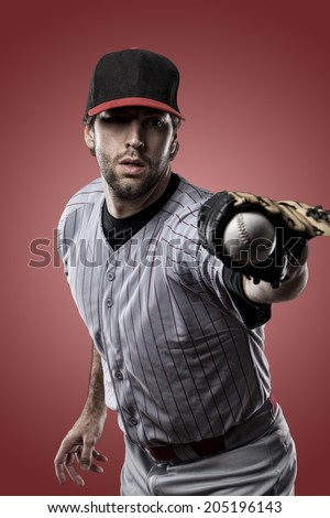 Baseball Player on a Red Uniform on red background.