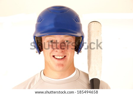 baseball player portrait smiling holding a bat - stock photo