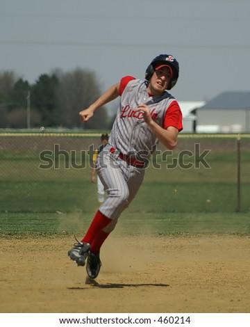 baseball player running the bases - stock photo