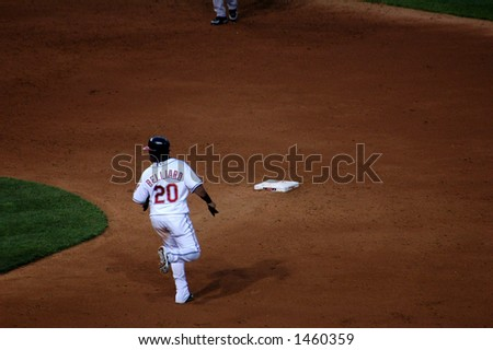 Baseball player running to second base - stock photo