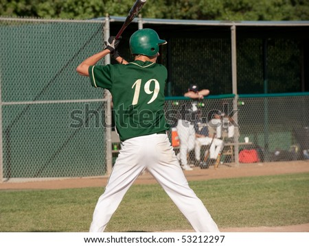 baseball team looking onto game in progress - stock photo