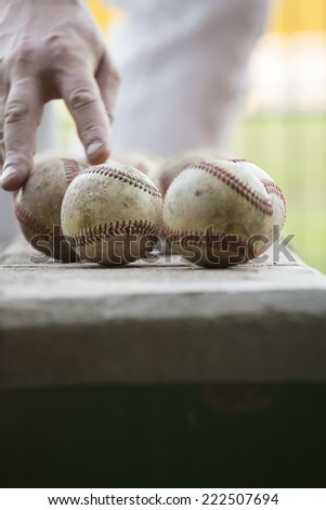 Baseball with hand - stock photo