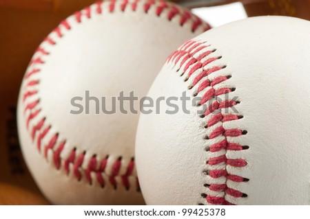 baseballs in a glove - stock photo