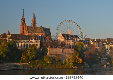 Basel Cathedral and Giant Wheel during the Autumn Fair (Herbstmesse) - stock photo