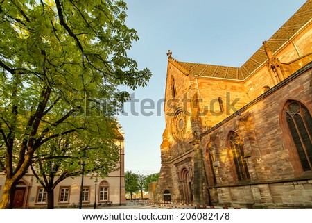 Basel cathedral in shade of evening sun - stock photo