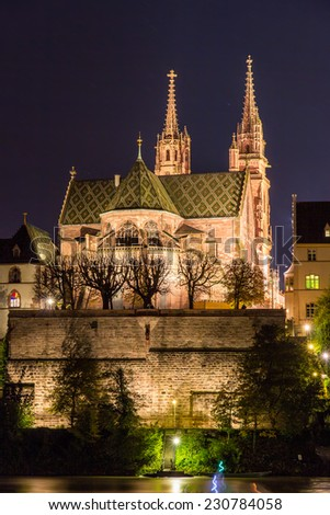 Basel Minster over Rhine by night - Switzerland - stock photo