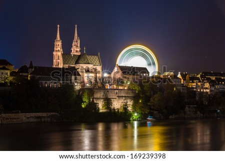 Basel Minster over the Rhine by night - Switzerland - stock photo