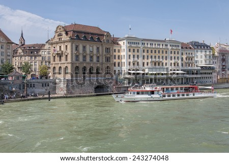 Basel, Switzerland - 6 August, 2014: cityscape with the Lallekonig ship on the Rhine river. Basel is Switzerland's third most populous city located where the Swiss, French and German borders meet.