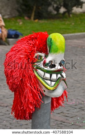 BASEL, SWITZERLAND - FEB 19: Carnival parade on February 19, 2013. A colorful parade of carnival masks in the city of Basel revives a centuries old tradition of masked and costumed performances.