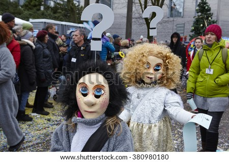 BASEL, SWITZERLAND - FEBRUARY, 15. Some fully costumed carnival activists walk through the city during the carnival procession of the Carnivel at Basel 2016 (Basle - Switzerland) on February 15, 2016.