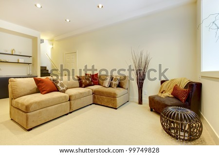 Basement area with living room and bathroom near bar. - stock photo
