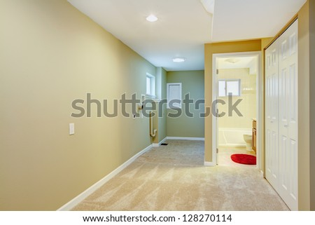 Basement hallway with laundry space and bathroom. New home. - stock photo