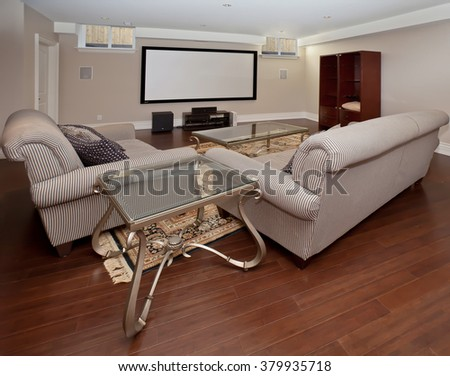 Basement home theater in new luxury house - stock photo