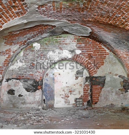 Basement of old fortress with vaulted brick ceiling - ancient dungeons - stock photo