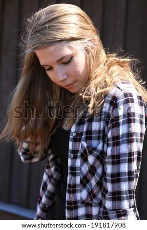 Bashful teenage girl - stock photo