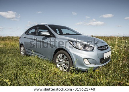 Bashkortostan, Russia - August 3, 2015: Car Hyundai Accent in nature.