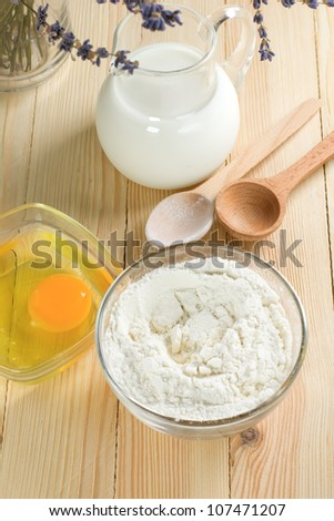 Basic ingredients for dough. Milk, eggs and flour.