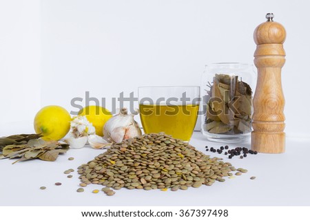 Basic ingredients to cook lentils soup, traditional recipe. On white background - stock photo