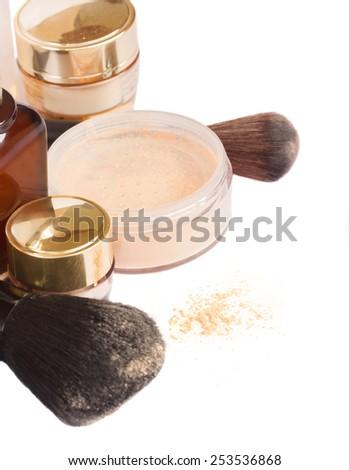 Basic make-up products - foundation, powder close up isolated on white background - stock photo