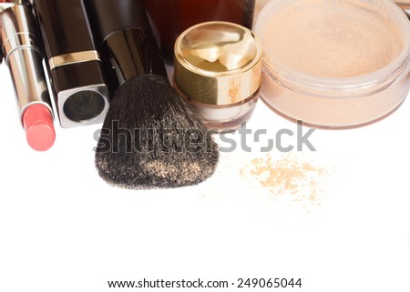 Basic make-up products with brushed border isolated on white background - stock photo
