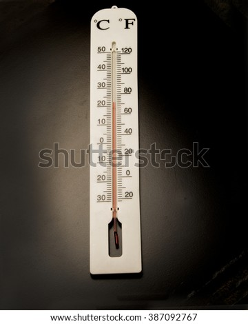 Basic weather instrument on black background/Thermometer/White temperature gauge on black background