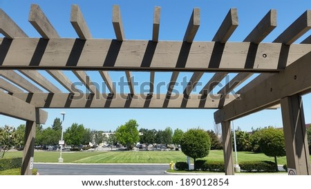 Basic wooden pergola in the backyard - stock photo