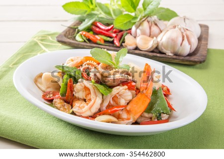 Basil Fried with mixed seafood. - stock photo