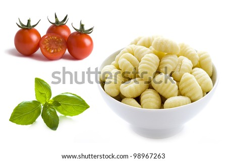 basil leaves, cherry tomatoes and gnocchi in a bowl