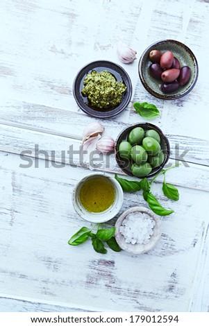 Basil Pesto, Olives, Sea Salt  and Olive Oil - stock photo
