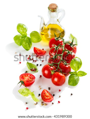 Basil, tomatoes, olive oil, pepper, garlic isolated on a white background.