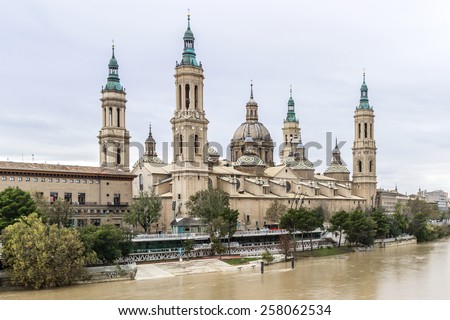 Basilica - Cathedral of Our Lady of Pillar and Ebro River in Zaragoza, Aragon, Spain. Pilar cathedral is Roman Catholic Church. - stock photo