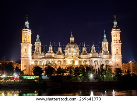 Basilica Del Pilar in Zaragoza in the night from reflection in the river, Spain - stock photo