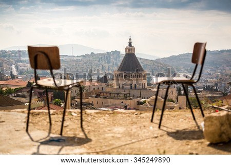 Basilica of Announciation with chairs as foregroung in Nazareth, Israel . - stock photo
