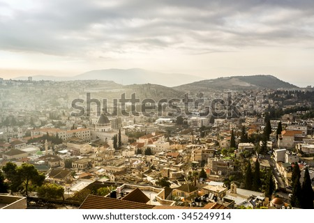 Basilica of Annunciation among other buildings in Nazareth, Israel . - stock photo
