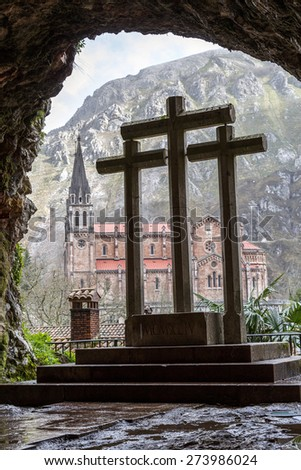 Basilica of Our Lady of Battles, Covadonga, Asturias, Spain. Crosses from the holy cave - stock photo