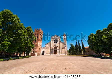 Basilica of San Zeno (X-XI century) and Abbey tower (XII-XIII century) in Verona Italy. Is considered one of the masterpieces of Romanesque architecture in Italy - stock photo