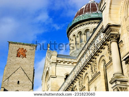 Basilica of St Martin and Charlemagne tower (remaining of huge early medieval basilica) at backgrounds in the old center of the city of Tours. (Val de Loire, France)  - stock photo