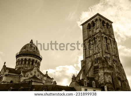 Basilica of St Martin and Charlemagne tower (remaining of huge early medieval basilica) in the old center of the city of Tours. (Val de Loire, France) Aged photo. Sepia. - stock photo
