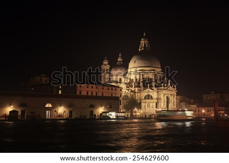 Basilica Santa Maria della Salute at night, Venice and Grand Channel  - stock photo