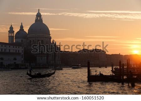 Basilica Santa Maria della Salute in Dorsoduro, Venice. Gondola and vaporetto in the Grand Channel  - stock photo