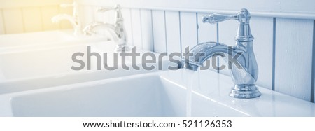 Basin in washroom with soft light tone