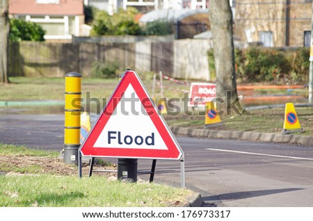 BASINGSTOKE, ENGLAND - FEBRUARY 16 2014: Flood warning sign ahead of a road closed by flood waters in Basingstoke.  Rising ground water levels have forced many residents to evacuate the area.